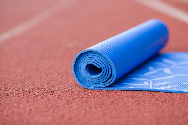 yoga mat on running track